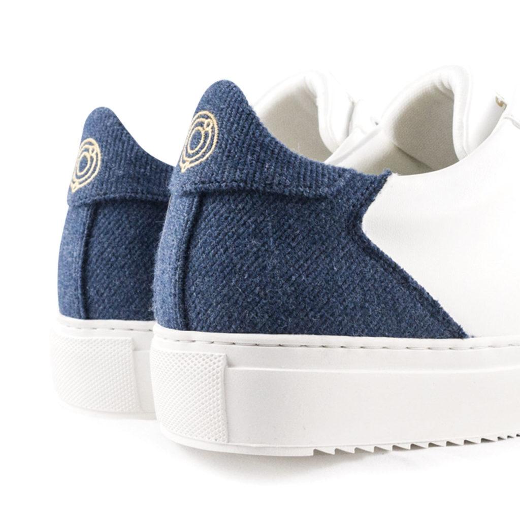 white and blue vegan sneaker